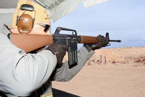 Roy Hill from Brownells fires the firm's new BRN Proto Retro Rifle which is based on the original AR-15 prototype. (Military.com/Matthew Cox)