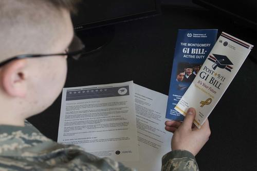 Airman Dalton Shank, 5th Bomb Wing Public Affairs broadcast journalist apprentice, reads pamphlets on the Montgomery GI Bill and the Post-9/11 GI Bill at Minot Air Force Base, N.D., March 10, 2017. (U.S. Air Force/Airman 1st Class Alyssa M. Akers)